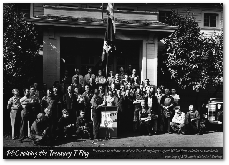 P&C factory employees raising treasury flag