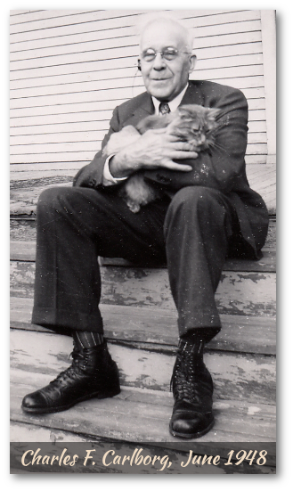 Charlie Carlborg with friendly cat,1948